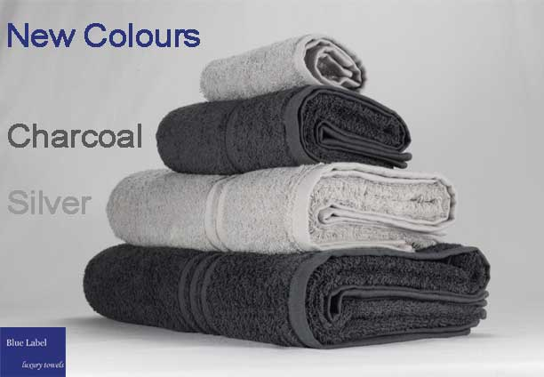 Blue Label towel range in light silver grey and charcoal grey.